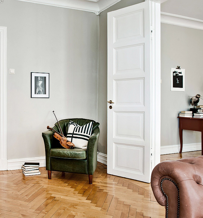 via coco alpine green velvet chair on chevron wood floor