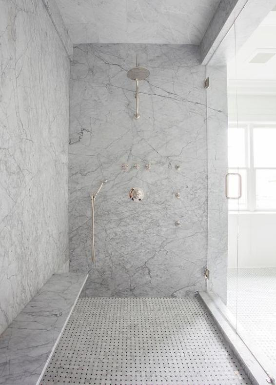 gray marble shower with long bench
