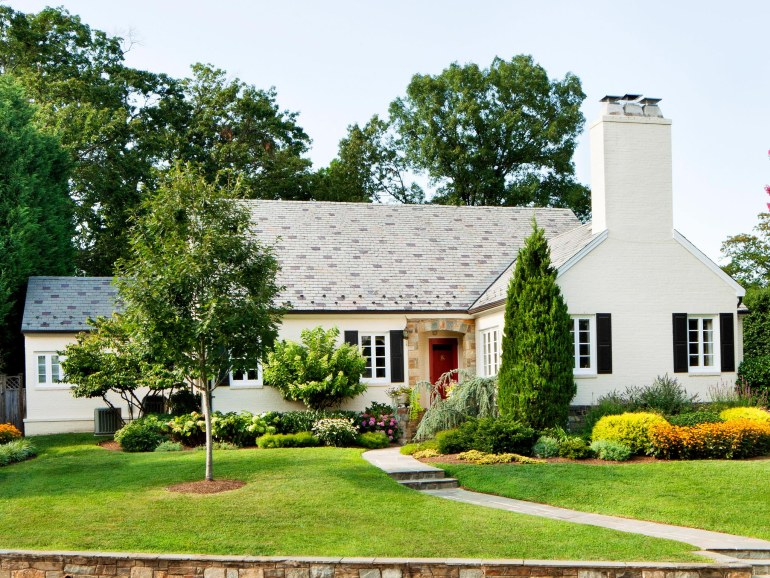Painted Brick Home, Stone Entry, Red Front Doors, Slate Roof, Stone Retaining Walls, Black Shutters