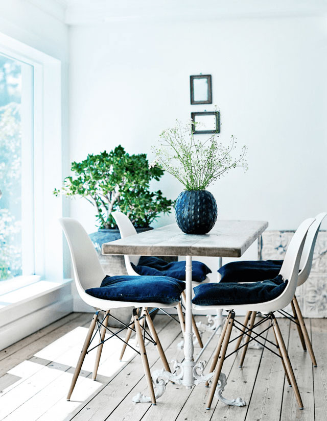 Soft Blue Walls, Light Filled Breakfast Nook, Modern Molded White Chairs, Wood Table with White Iron Base, Navy Blue Chair Cushions