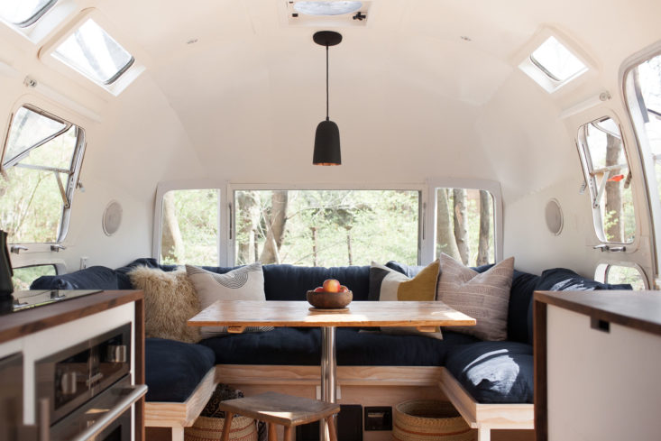 modern-caravan-vintage-airstream-renovation-dining-733x489.jpg