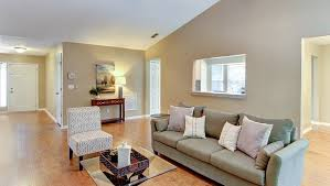 Under furnished, Beige Walls, Great Room, Unappealing To Buyers. Furniture Out of Scale