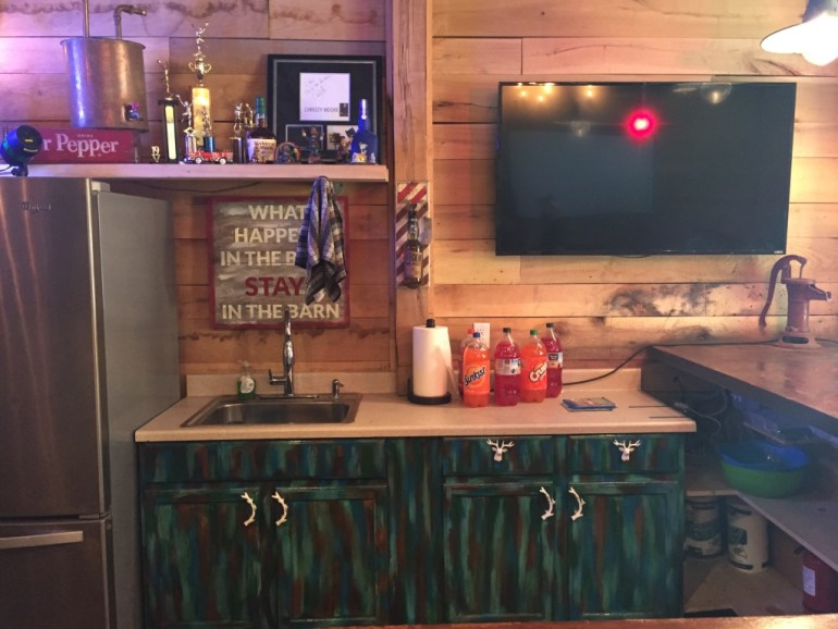 TV In Barn Over Bar, Camo Cabinets, Antler Cabinet Hardware
