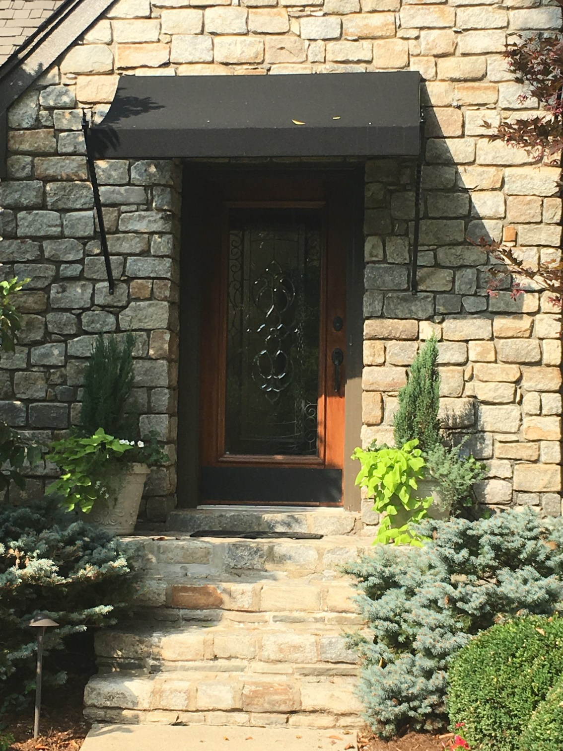 Stone Steps, Wood Decorative Glass Entry Door, Black Canvas Awning