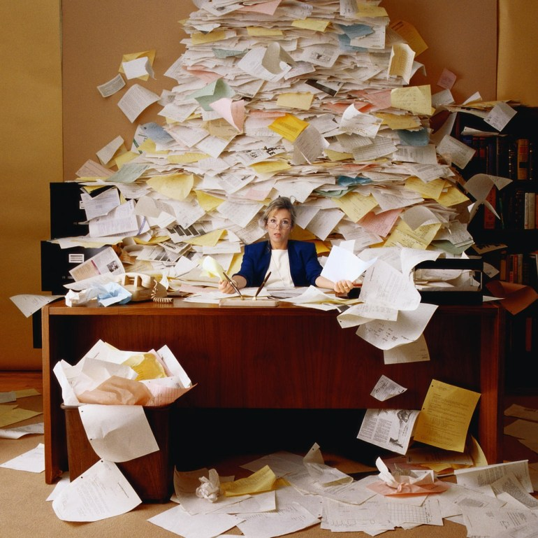 Messy Desk Covered In Paper