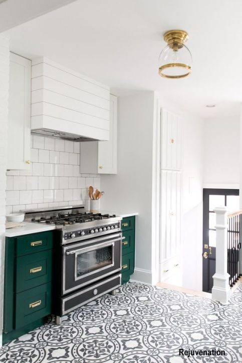 Dark Green Cabinets, Black and White Cement Floor with Black and Stainless Range