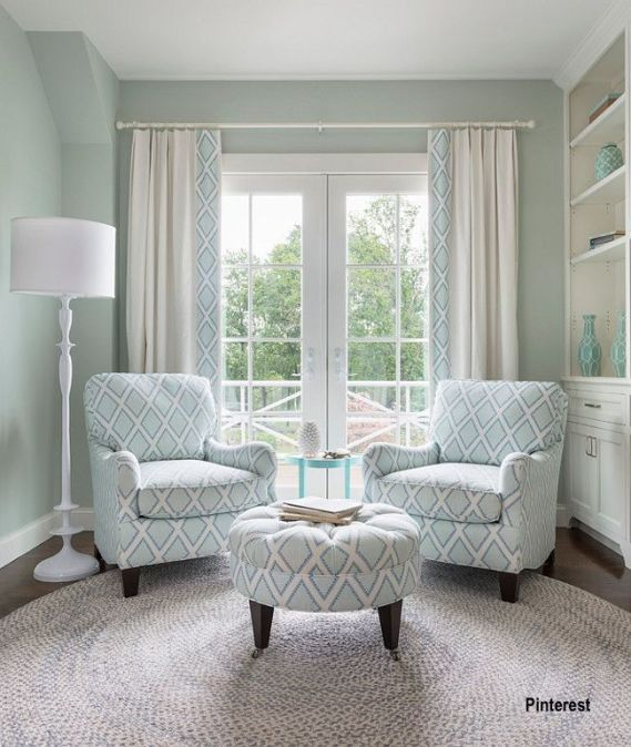 Aqua Painted Walls, Large Pattern Fabric Pair of Chairs and Matching Ottoman, White Floor Lamp and Hand Braided Round Rug
