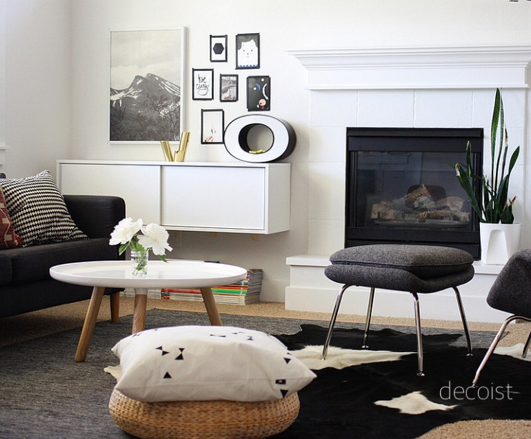 via decosit modern small living room with hide rug, wall storage, black and white decor