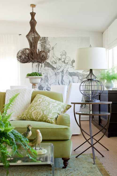 Classic Living Room with Lime Green Sofa, Woody Light Fixture, Birdcage Lamps , Large Sketch Art