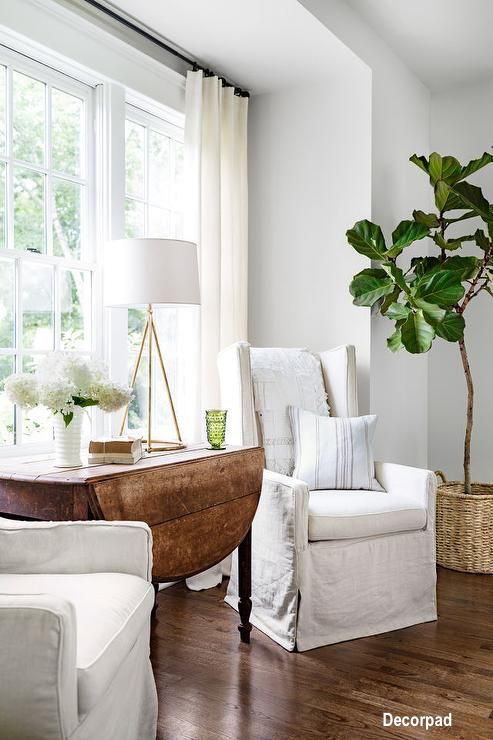 White Linen Slip Covered Chairs, Nook Seating Areas, Fiddle Leaf Ferns In Decor, Wood Drop Leaf Table