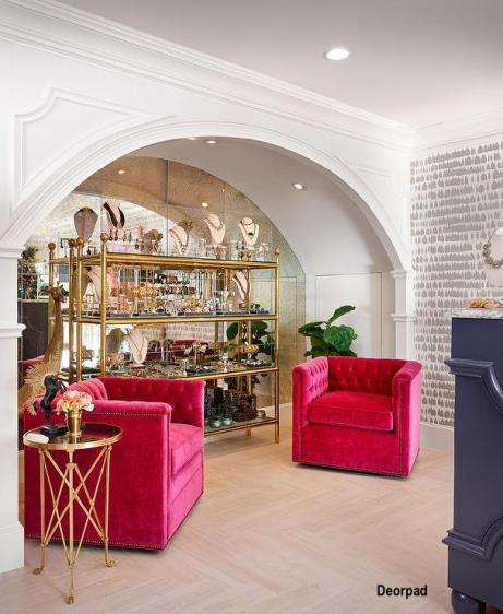glam-dressing-room-hot-pink-velvet-chairs-brass-glass-jewelry-shelving-unit
