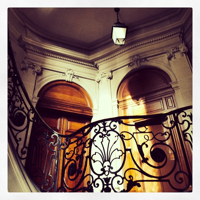 Parisan Curly Iron Staircase, Stone Doorways with Stained Wood Arched Doors