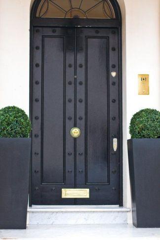 Black doors make a statement! -via pinterest