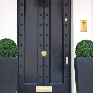 Black doors make a statement! -via pinterest