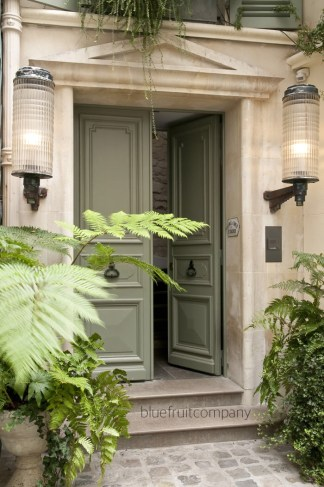 Blue Fruit Company shares this classic stone home with the perfect color green doors.