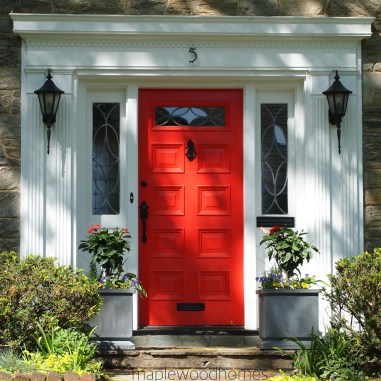 Red Doors Look Best With Bright White Trim On Home Exteriors - via maplewoodhomes