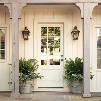Sometimes the most simple door color has the most impact. Tone on tone creamy ivory is just perfect in this home featured on pinterest.