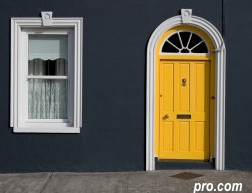 what an impact with this yellow front door deep set in a grey exterior via pro.com