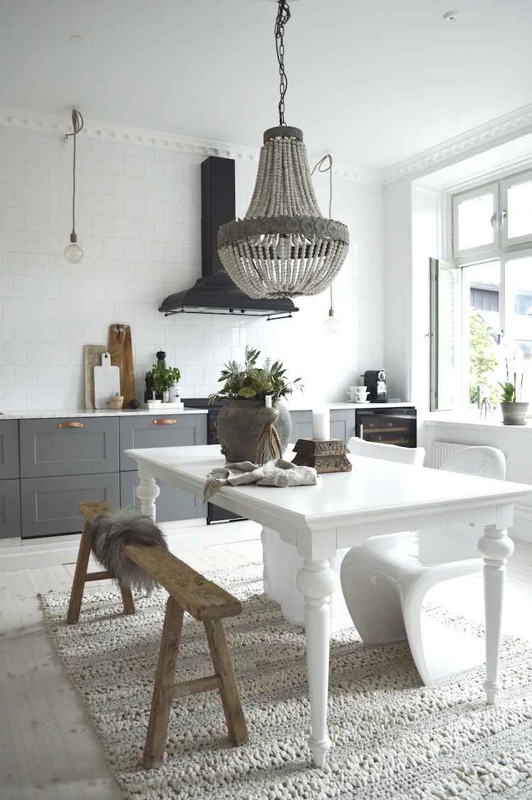 My Scandinavian Home White Dining Table in Light Filled Kitchen