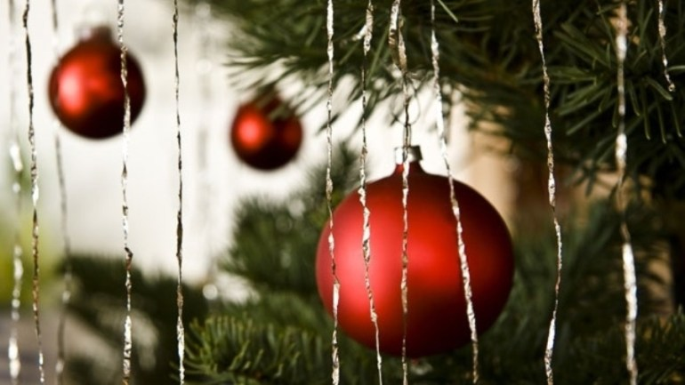christmas tree with tinsel and red ball ornaments