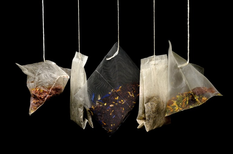 littleblackdomicile and tea bags on black background