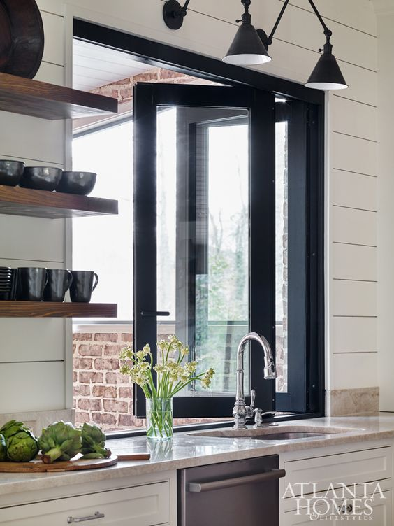 Atlanta Homes kitchen with hinged accordion window to outdoor area
