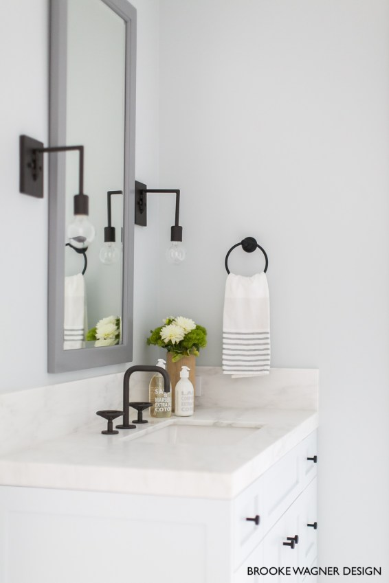 White Vanity and Counter Top with Black Faucets