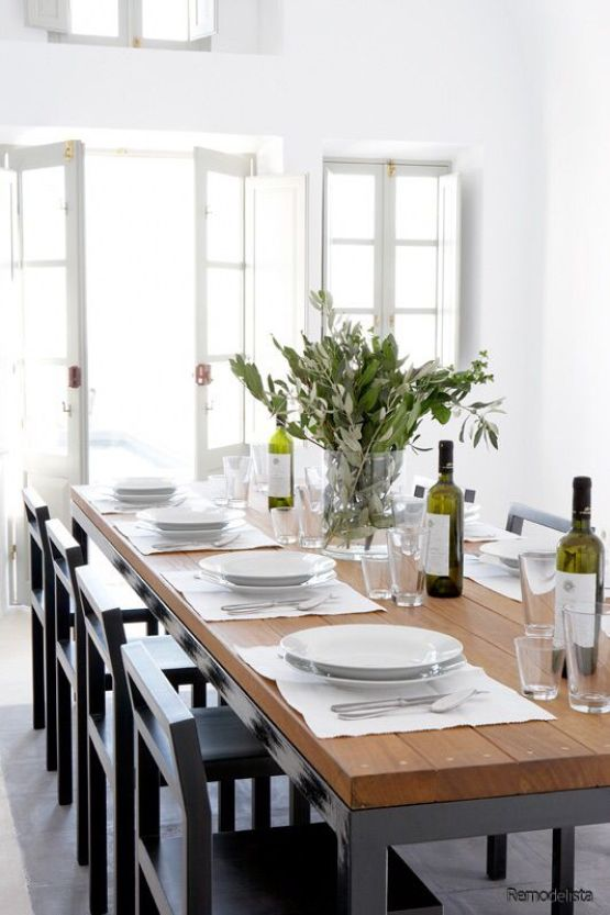 Remodelista Wood Table with White Dishes and Green Wine Bottles