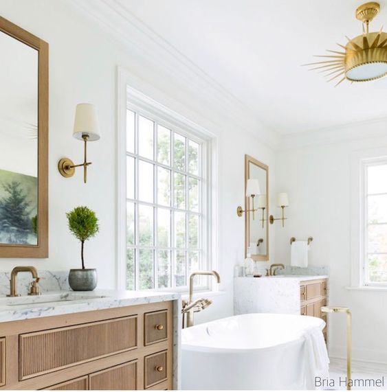 bria hammel bathroom design-freestanding tub-ribbed warm wood vanity-brass faucets-waterfall marble counter tops