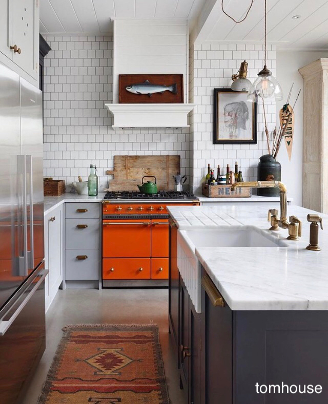 kitchen with orange range-4x4 tile splash-hanging pedant light-white-gray-charcoal cabinet colors-mantel range hood via tom house.com