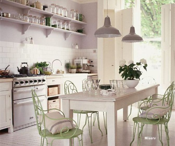 Miserv with painted kitchen table with green garden chairs