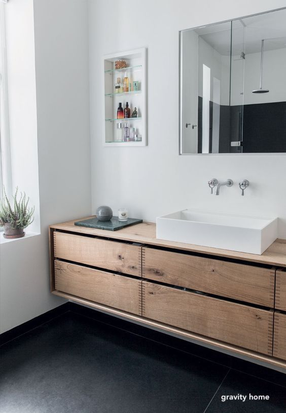 gravity home bathroom-elevated vanity-wall mount faucet-open medicine cabinet
