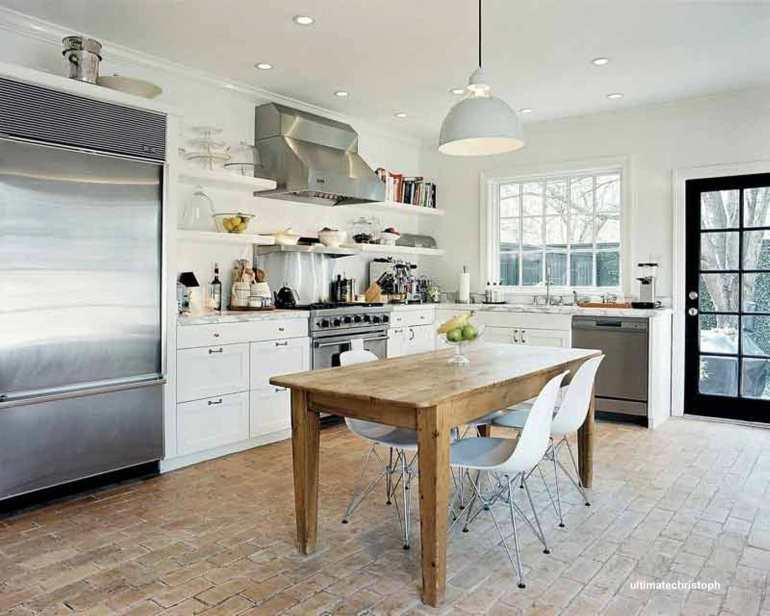 ultimatechristoph farm house kitchen table on brick floor in white kitchen