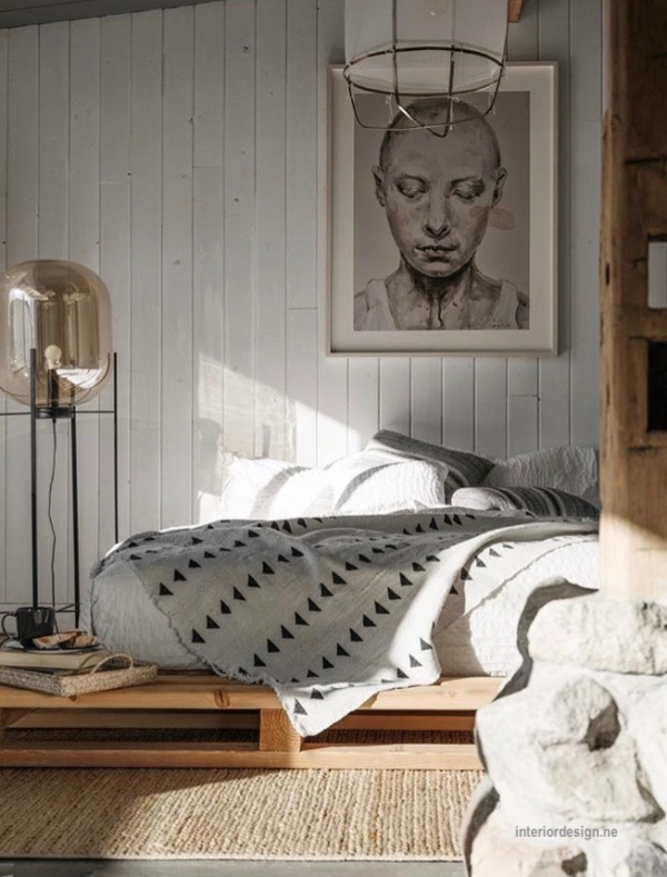 interiordesign.net bed on pallet, sunlight streaming on a series of blankets