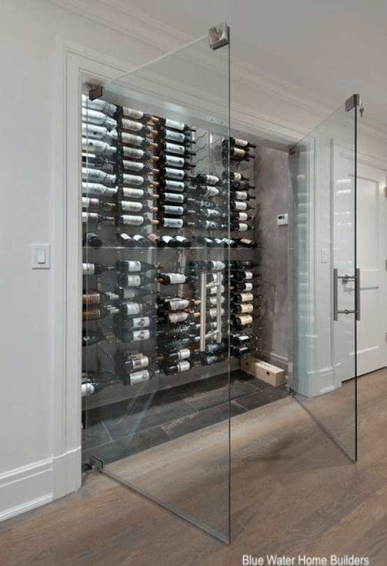 Blue Water Home Builders wine closet behind double glass doors cool tile floor
