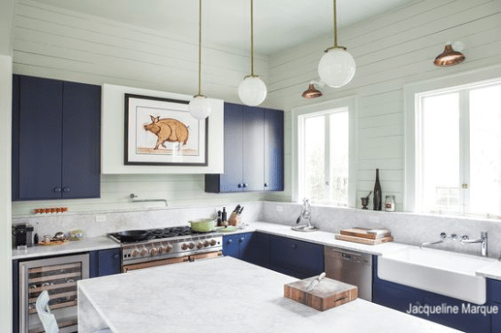 Jacqueline Marque simple range hood with pig art