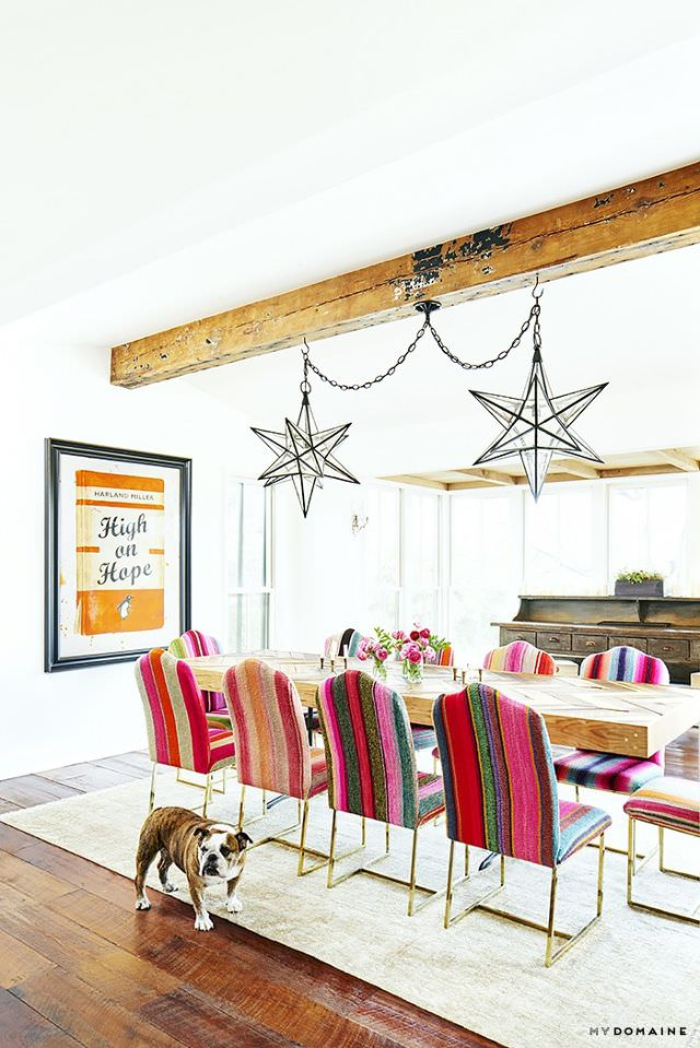 mydomaine- Peruvian-frazada-upholstery-wood ceiling beams-star statement light fxitures