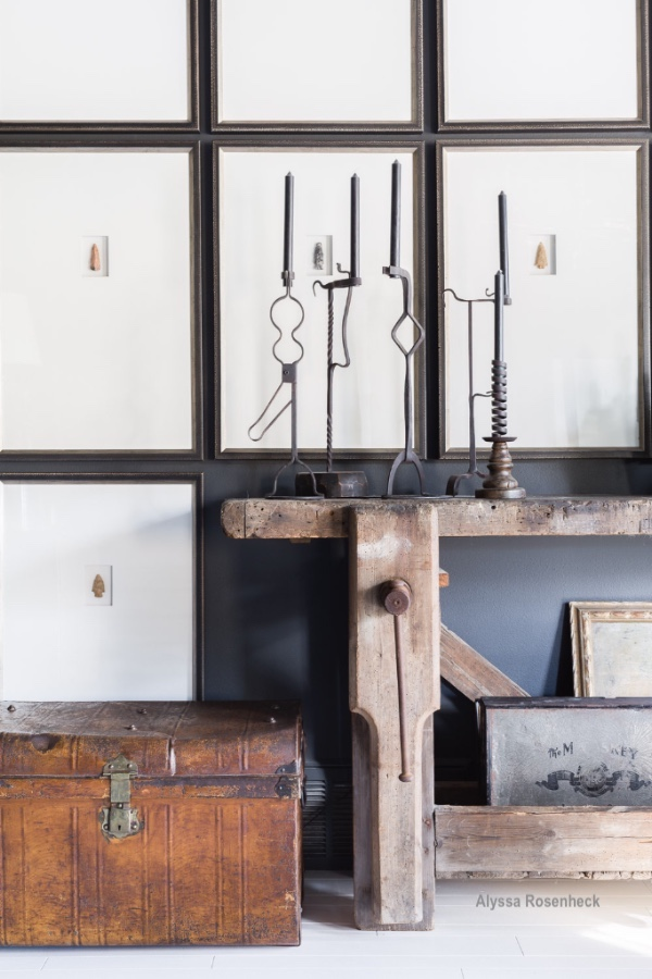 alyssa rosenheck wood bench, trunk and iron candlesticks textural elements