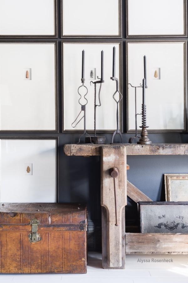 alyssa rosenheck wood bench, trunk and iron candlesticks textural elements