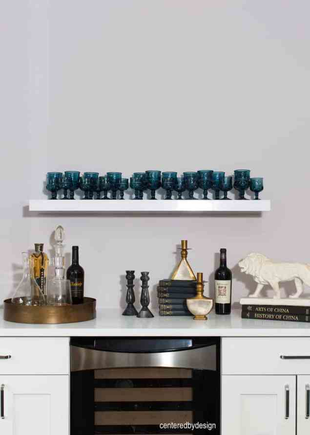 centeredbydesign -white cabinets-under counter ref-wall shelf-bar
