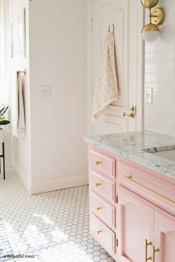 a beautiful mess-pink vanity-hexagon tile floor- brass hardware- blush walls-bathroom design-DIY bathroom