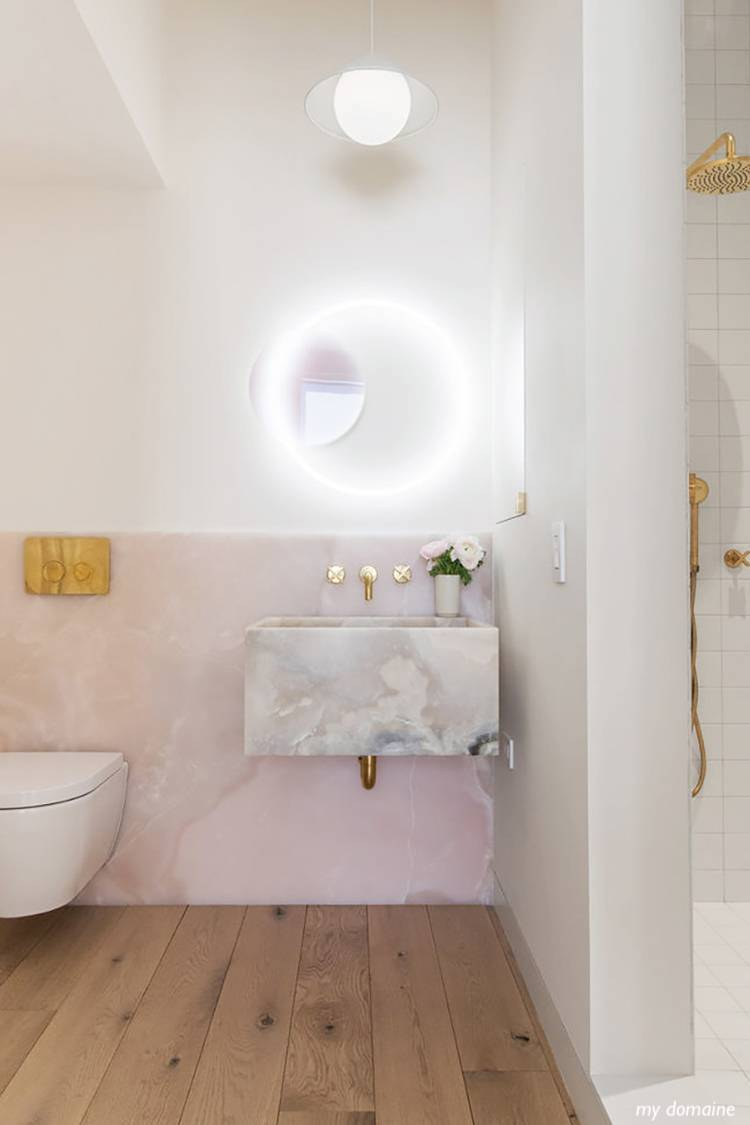 mydomaine-pink marble slab wall in bathroom