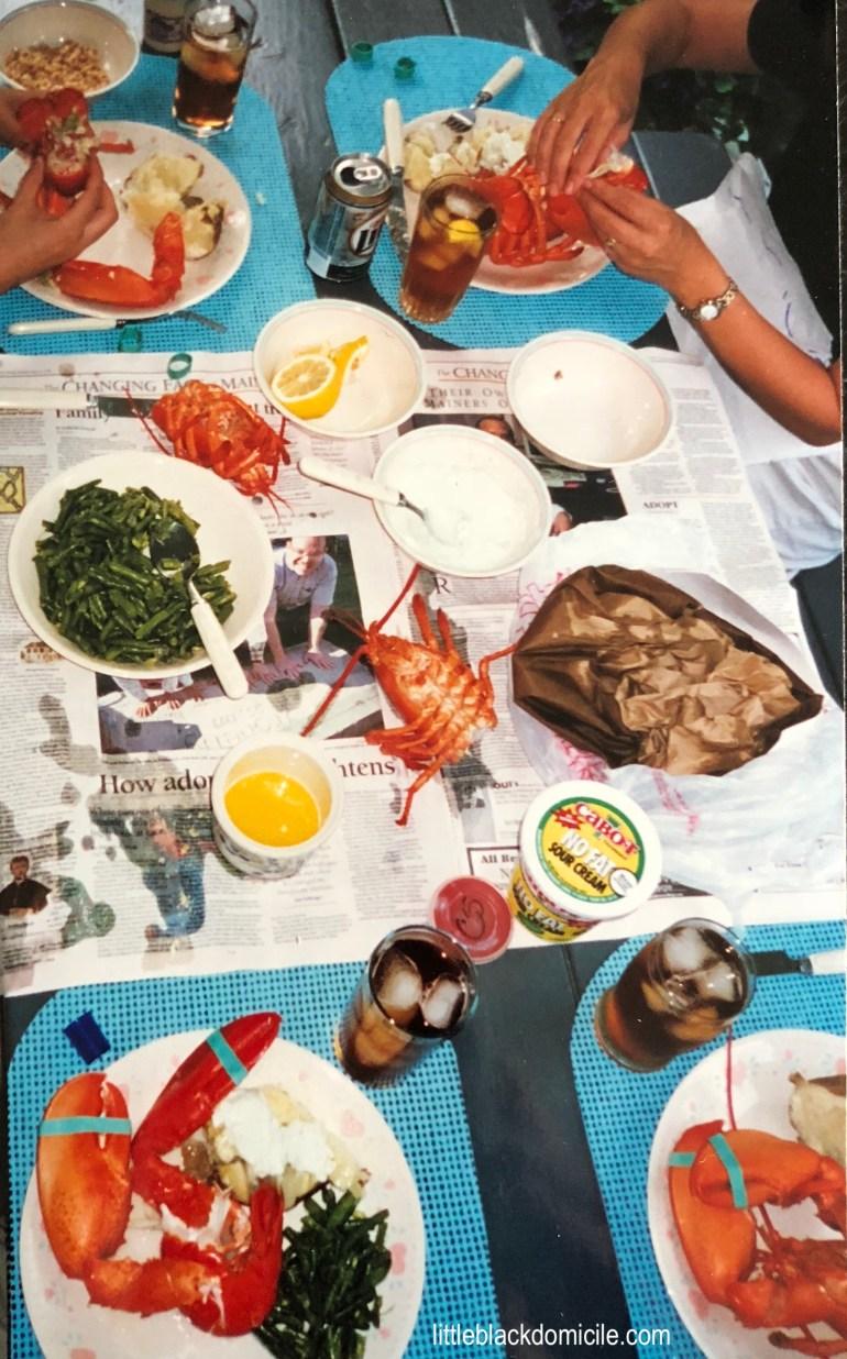 littleblackdomicile-lobster dinner-picnic table-newspapers-lemons- butter