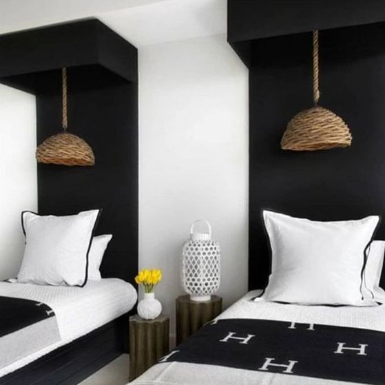 greyhuntinteriors - twin beds painted headboards- wicker lights- black and white interiors