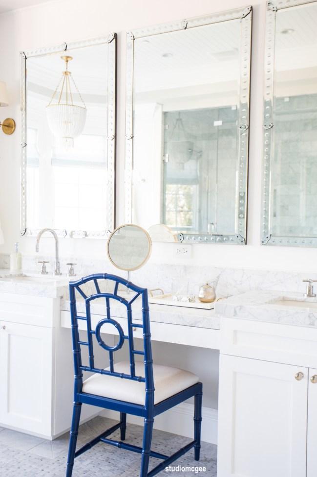Studio-McGee-All+white+bathroom,+marble+basketweave+floors,+venetian+mirrors+||+Studio+McGee