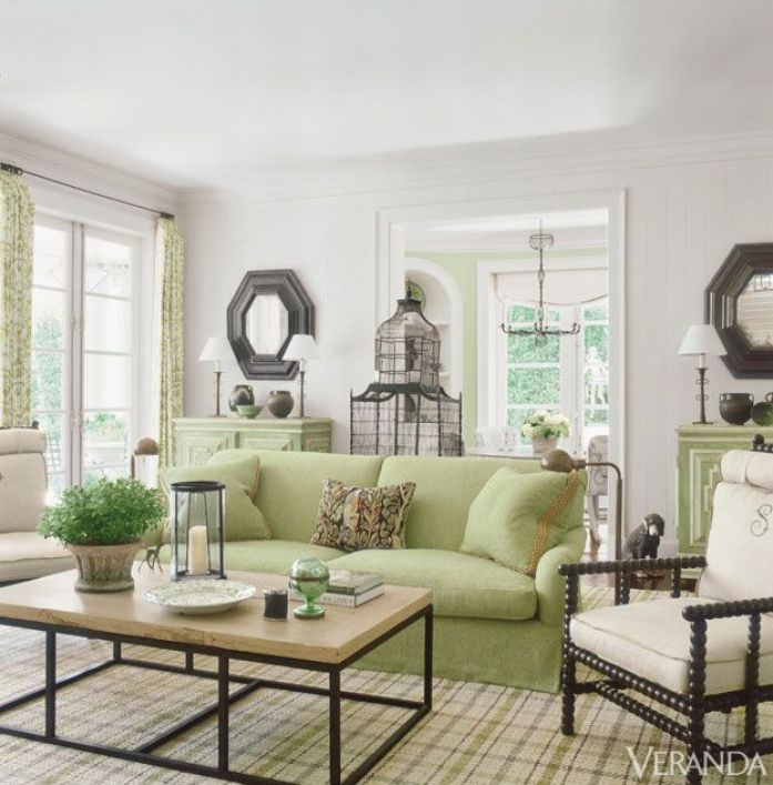 veranda-green-sofa-patterned-drapes-plaid carpet