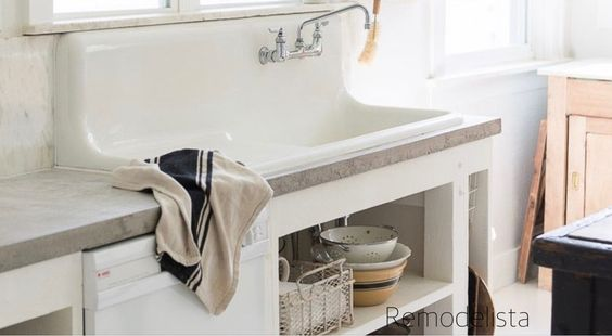 remodelista-large-cast-iron-sink-wall-mount-faucet-concrete-counter