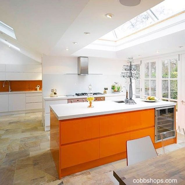 cobbshops.com-orange-cabinets-stone-floor