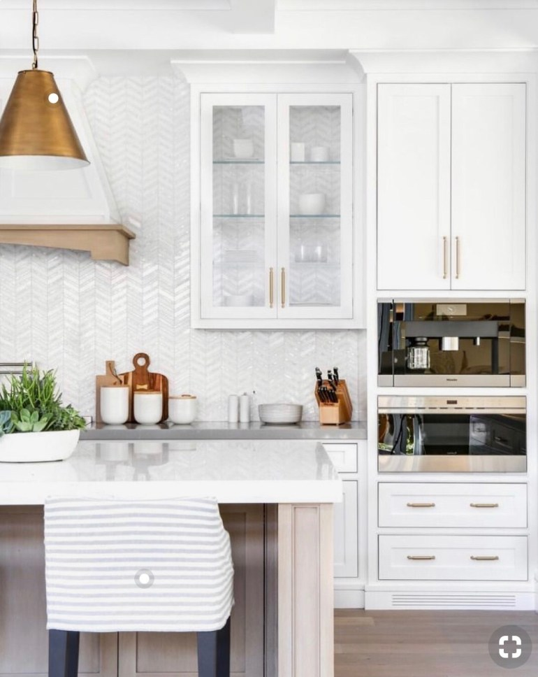 thehavenlist-white-kitchen-gold-light fixtures-washed woods-quartz counter tops