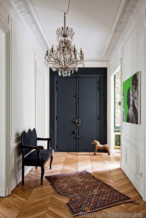 Stephan Martinache-black-entry-door-vintage-area-rug-crystal-statement-chandelier